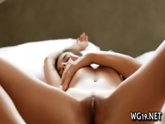 cutie plays with large sex-toy