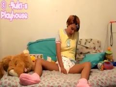 sexy cutie masturbates in diaper and yellow onesie